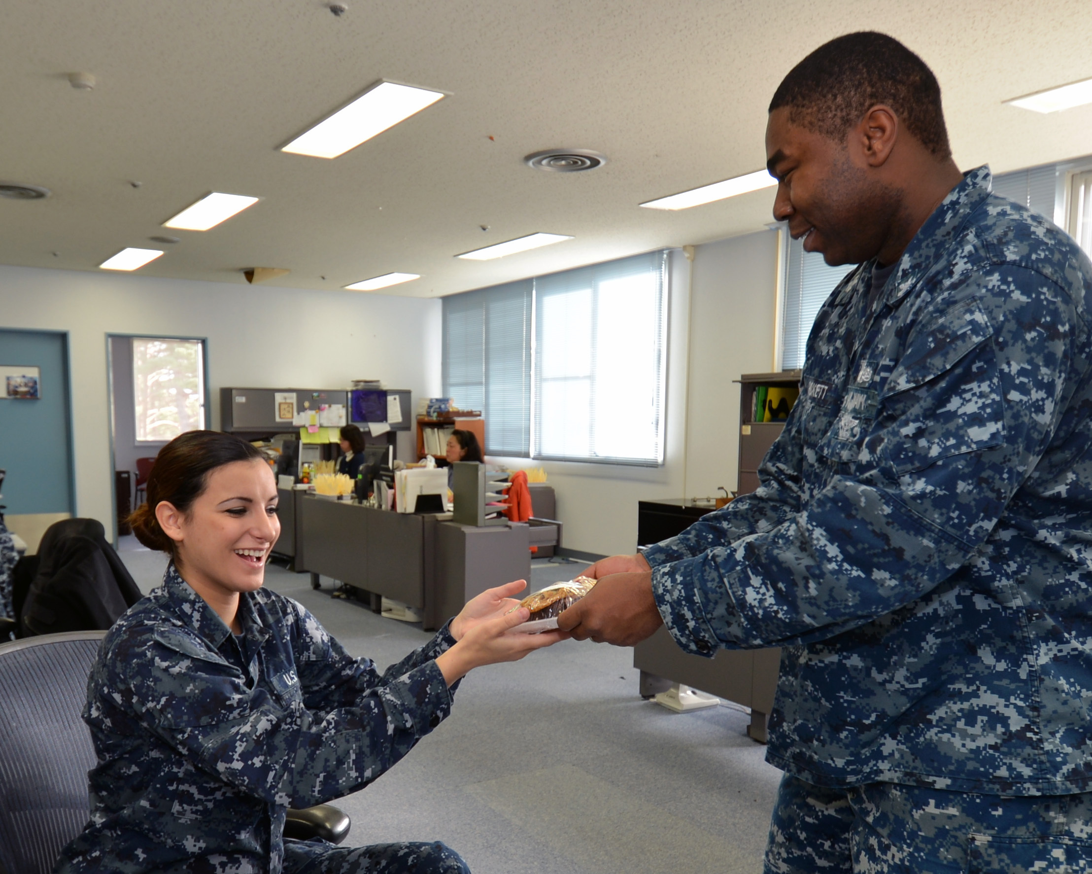 File:U.S. Navy Yeoman 1st Class Eric Pickett, right, delivers ...