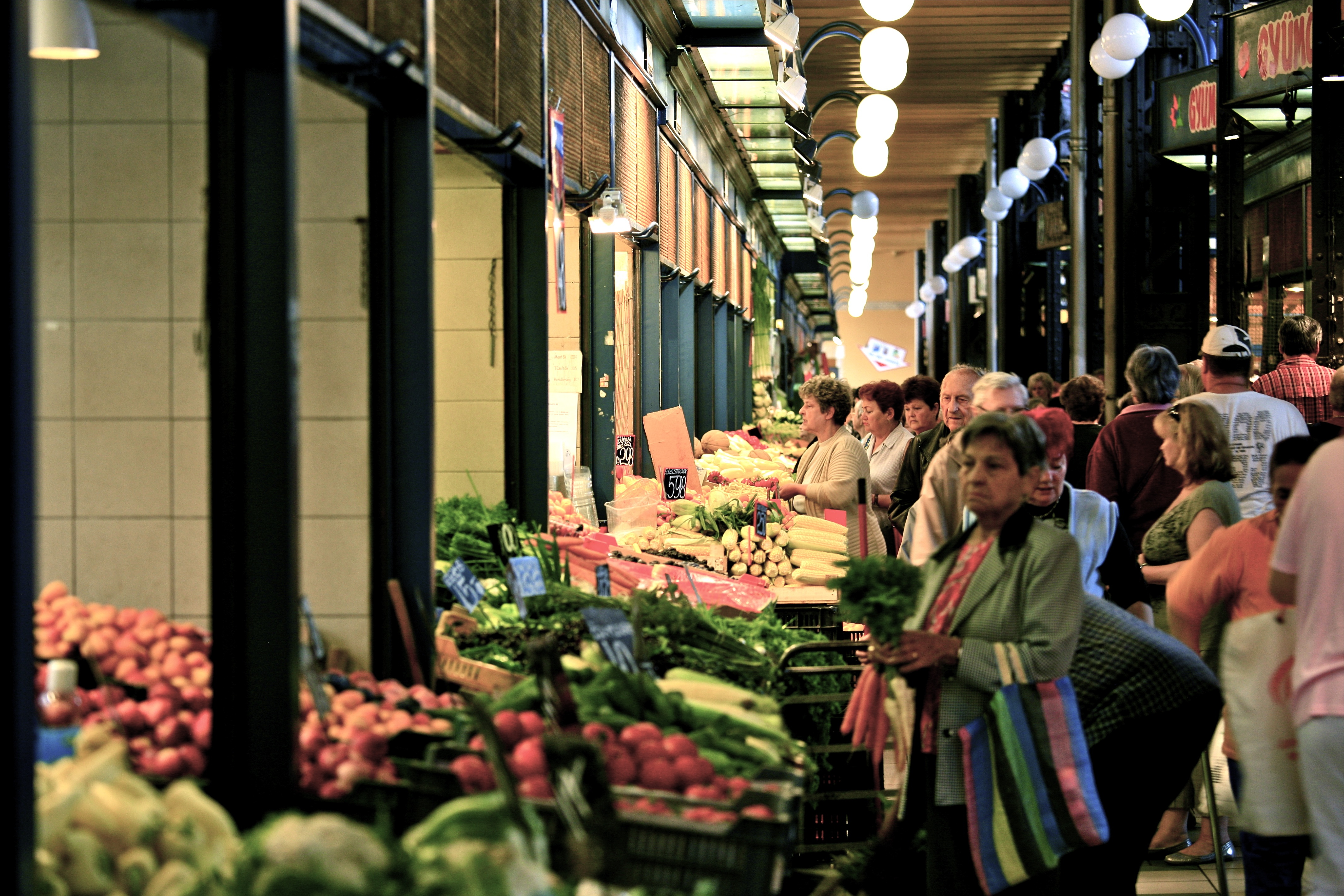 File:Buying in the Central Market (6003444575).jpg - Wikimedia Commons