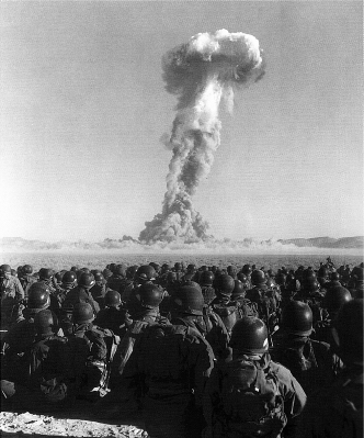 U.S. Army soldiers look on an atomic bomb test of Operation Buster-Jangle at the Nevada Test Site during the Korean War.