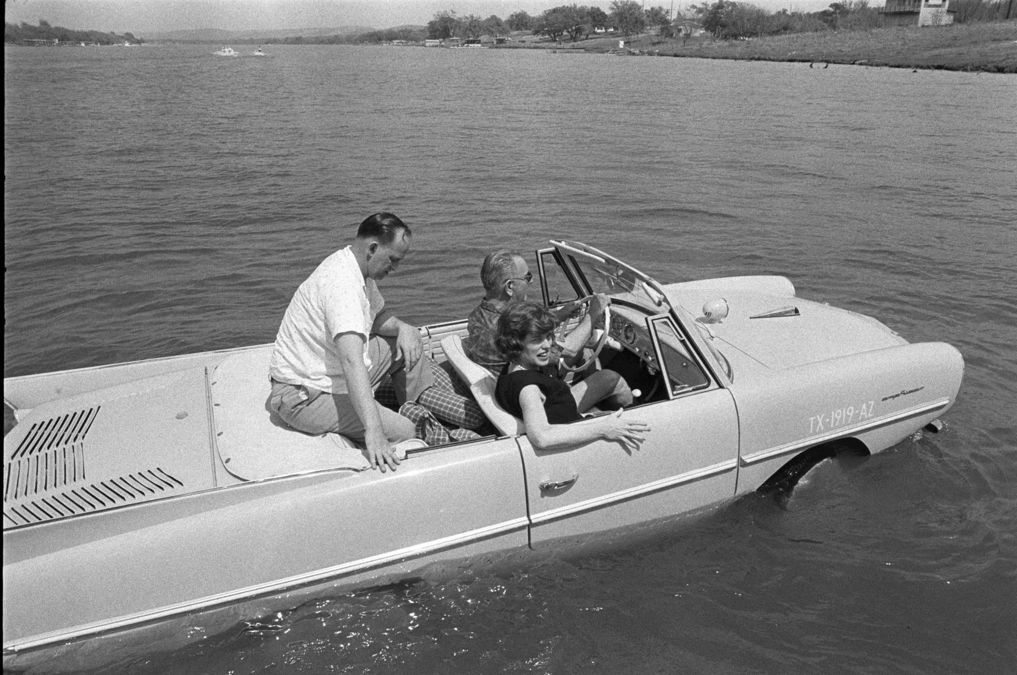 President Lyndon B. Johnson driving an Amphicar
