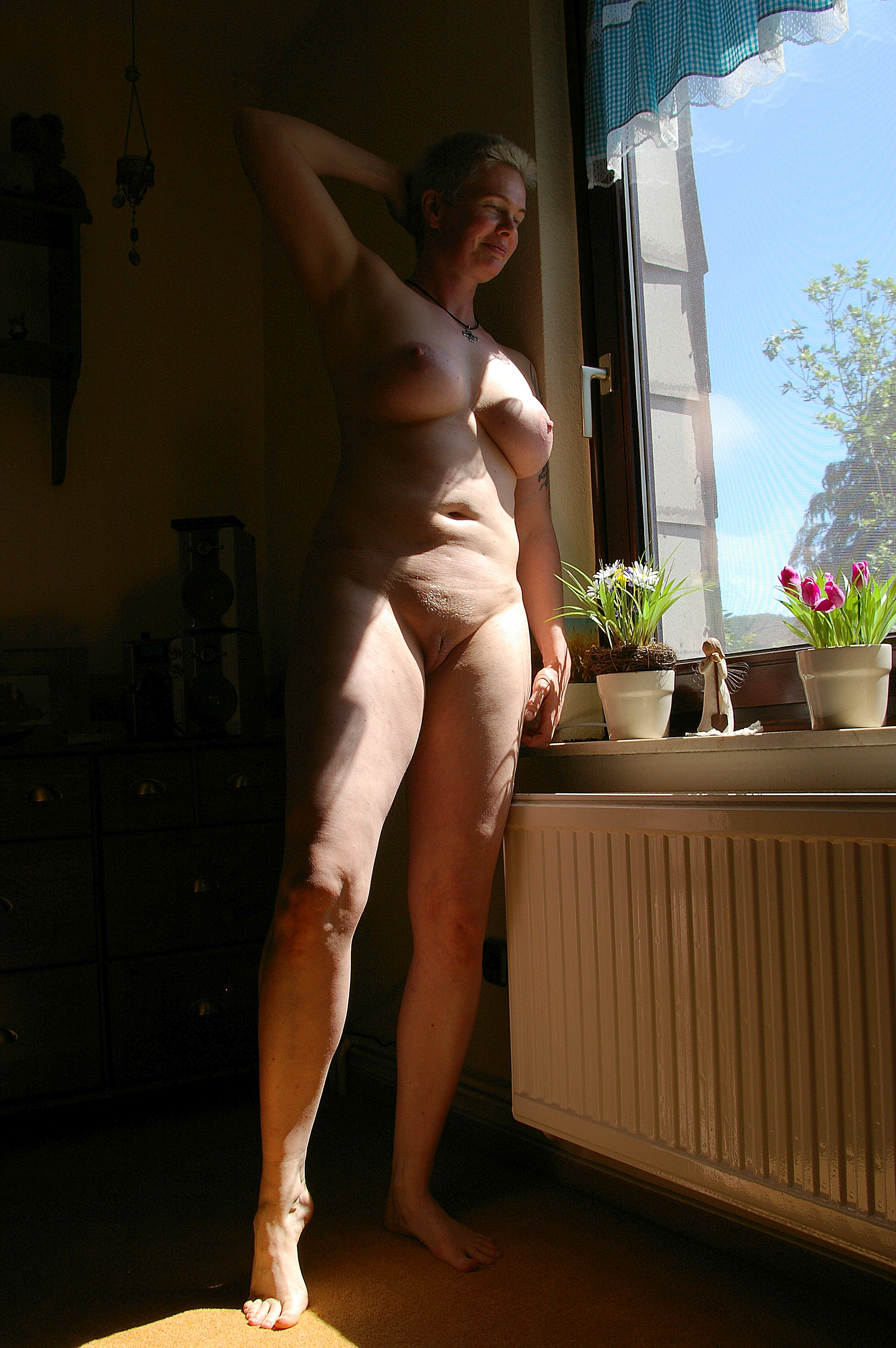 Naked in window