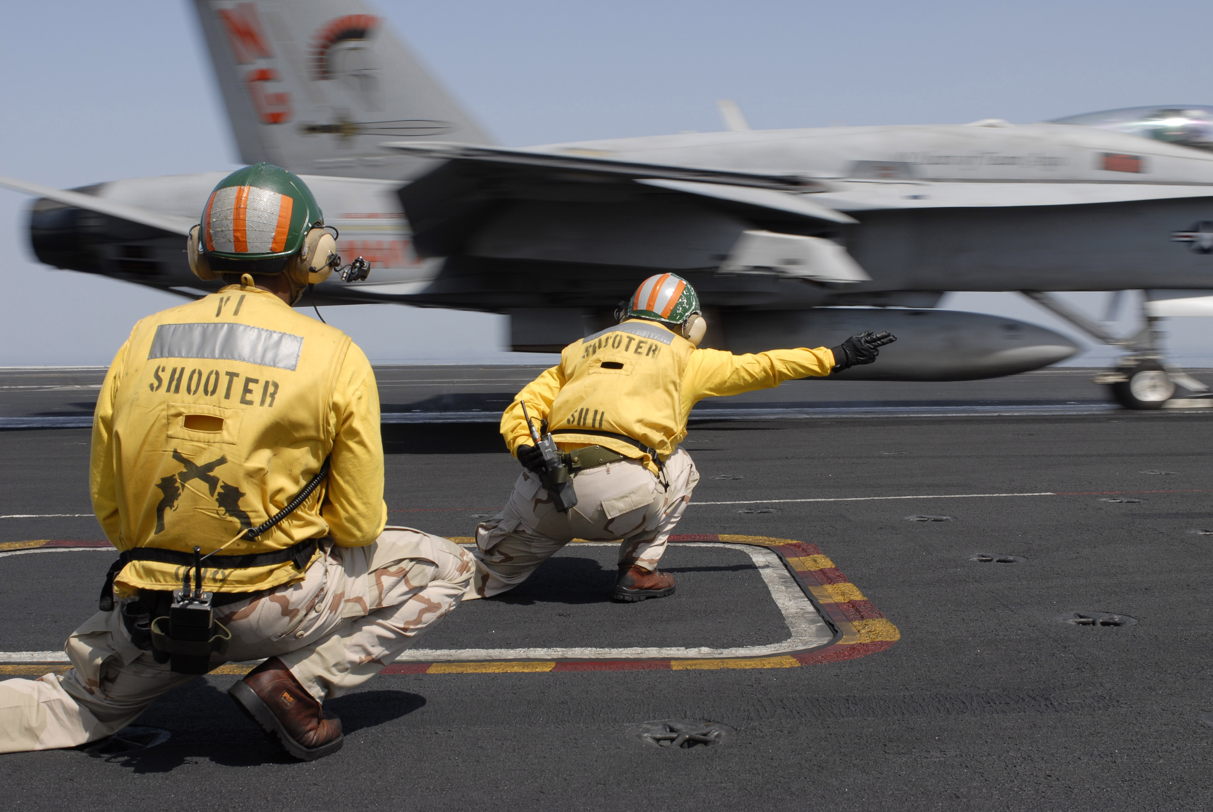 helicopter landing officer with File Us Navy 070313 N 8157c 001 Flight Deck Officers  Referred To As Shooters  Launch An F A 18c Hor  Assigned The Argonauts Of Strike Fighter Squadron  Vfa  146 Off The Flight Deck Of Nimitz Class Aircraft Carrier Uss John C  Ste on After Heathrow Crash How Safe IS Planes  puter moreover Aurora Unveils Evtol Aircraft further Helicopter Hand Signals wHcAmAWiXjIRPYxfu10VCg 6pZ4LtafTAOAS5R2VZ1E likewise File Airport Traffic Pattern from AIM 4 3 2 moreover Hmas Adelaide Enters Hobart Tasmania.