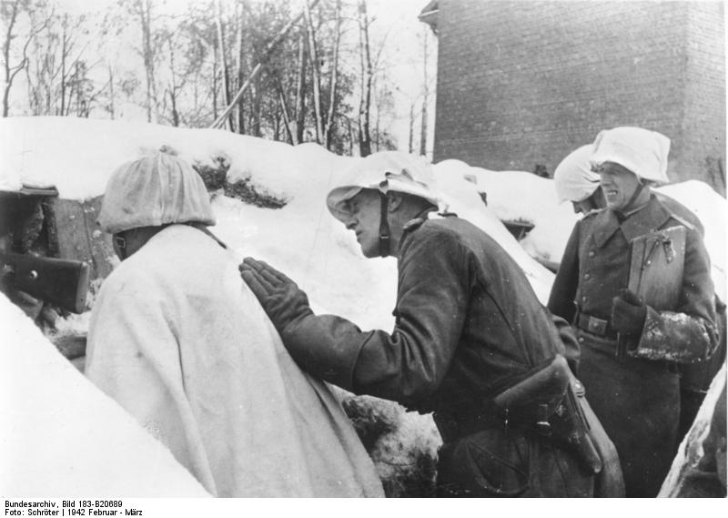 General Lindemann (center) inspecting infantry positions