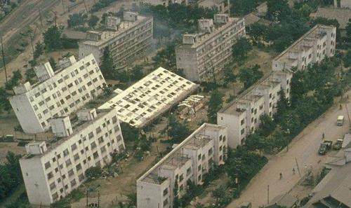An earthquake topples buildings