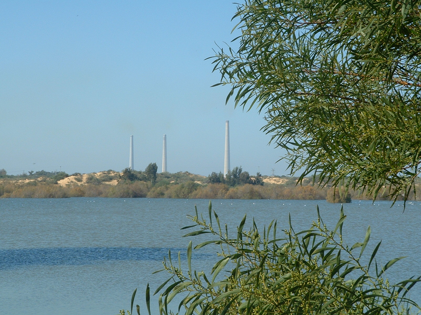 "Nahalei Menashe water project reservoir in Caesarea, Israel, Hadera ""Orot Rabin"" power station in the background. Water conservation, Israel, water management, water crisis, water resources, Middle East, desalinization. Image via RickP, Wikimedia Commons"