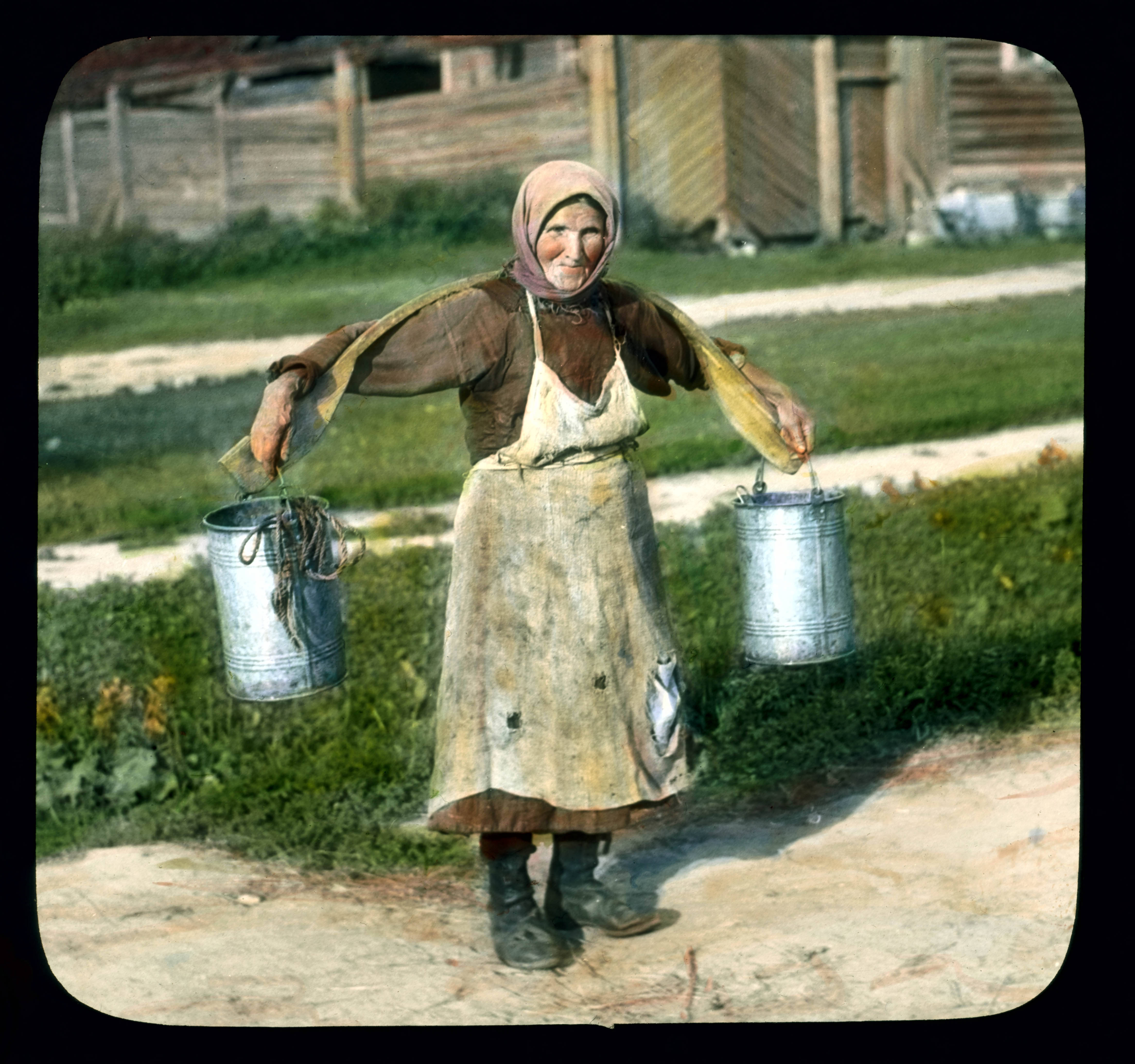 woman carrying buckets of water near leningrad