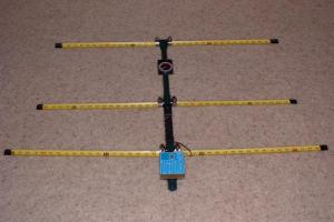 A portable Yagi-Uda antenna for use at 144 MHz (2 m), with segments of yellow tape-measure ribbon for the arms of the driven and parasitic elements. Two meter yagi.jpg