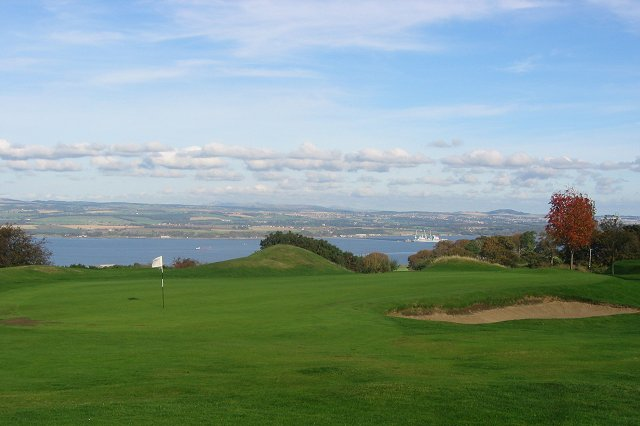 West Lothian Golf Club. View from the hilltop golf course,(on Airngath Hill) north across the Forth to Fife and the Navy supply base at Crombie.