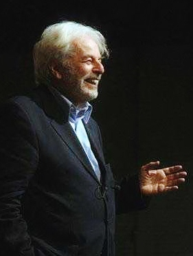 Jodorowsky giving a speech on spirituality.