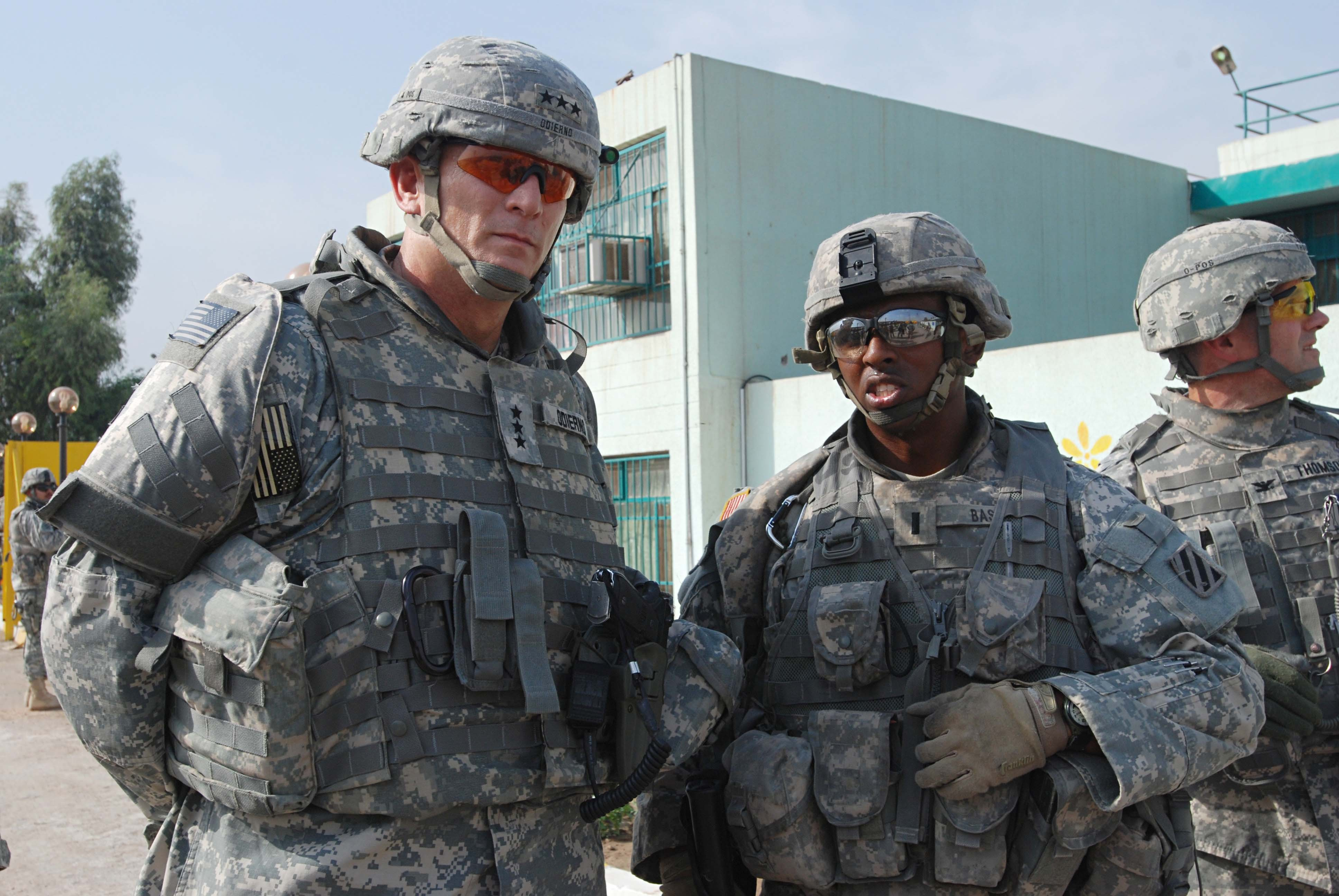 Lieutenant Helps to Renovate Orphanage for Iraqi Girls DVIDS62253.jpg English: Washington, D.C. native 1st Lt. William Bass (right), a fire