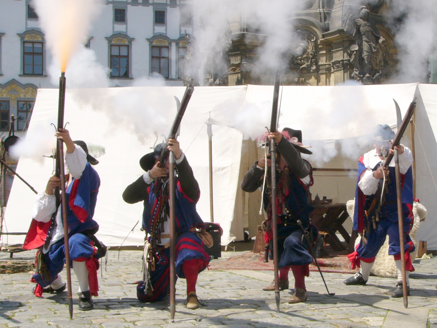Musketeers firing muskets in a historical reenactment from the Thirty Years' War.