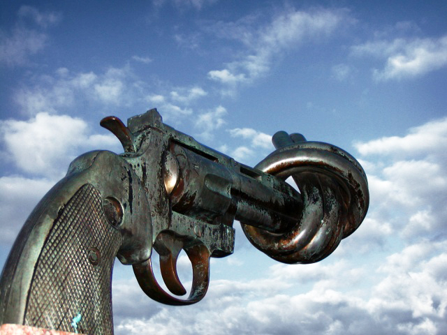 A sculpture of a magnum revolver with the barrel of the gun tied in a knot