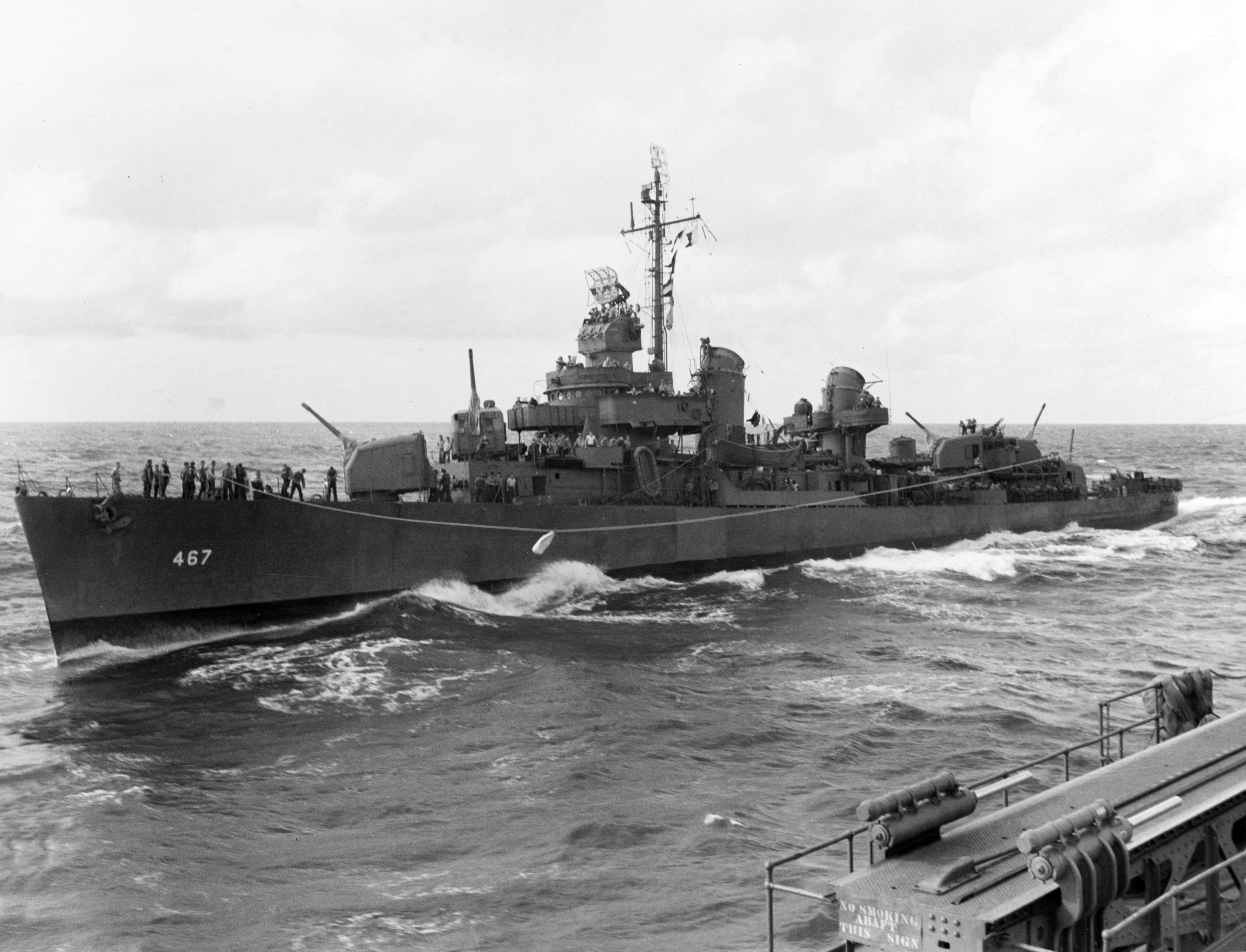Strong highlines mail to USS Honolulu during operations in the Solomons, July 1943.