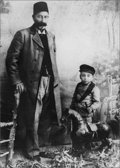 Wasif Jawhariyyeh and his father Jiryis Jawhariyyeh in a studio photograph circa 1900. The photograph was preserved in the Jawhariyyeh Collection and published by the Institute for Palestine Studies
