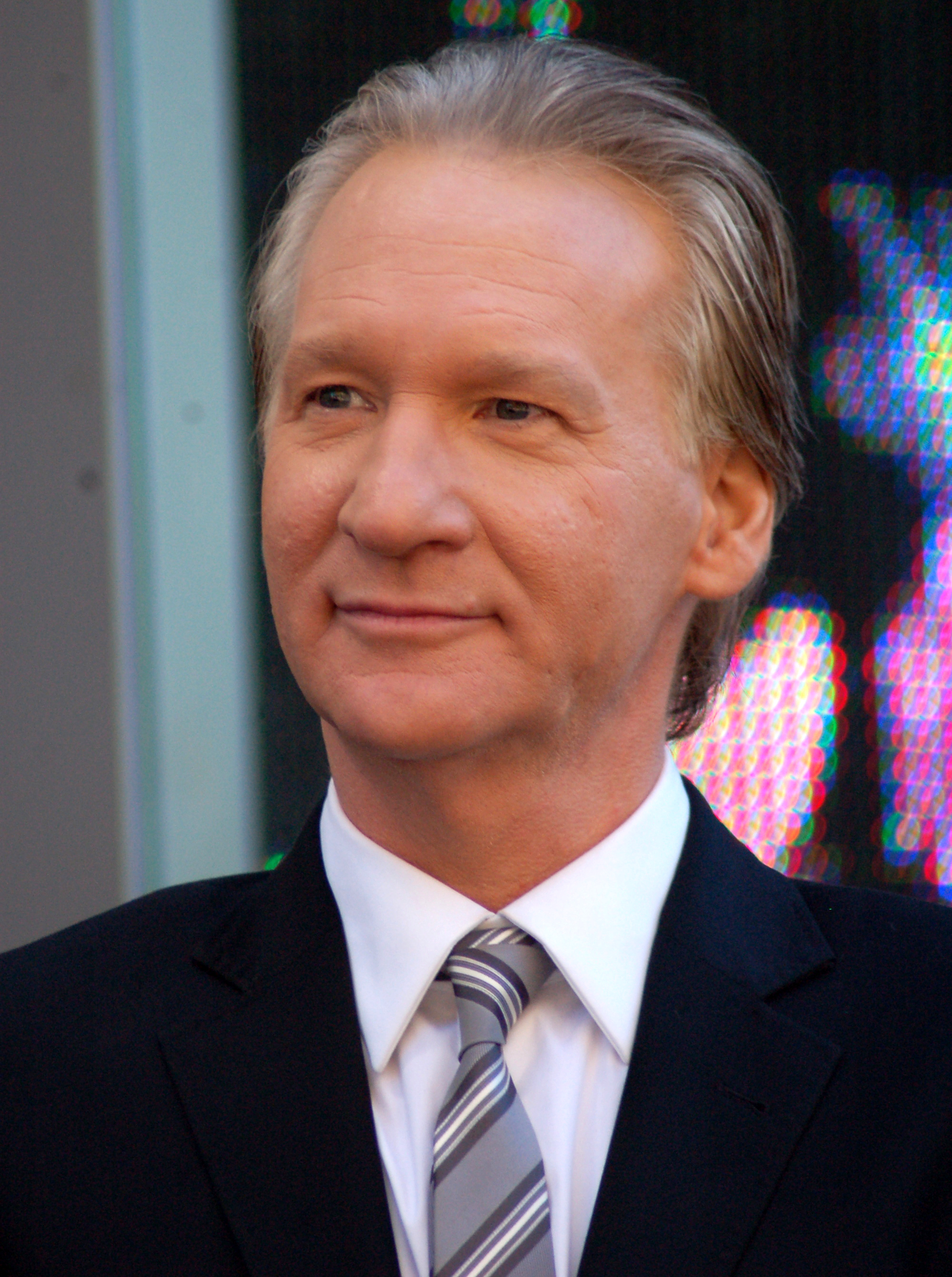 The 62-year old son of father William Maher, Sr. and mother Julie Maher, 173 cm tall Bill Maher in 2018 photo