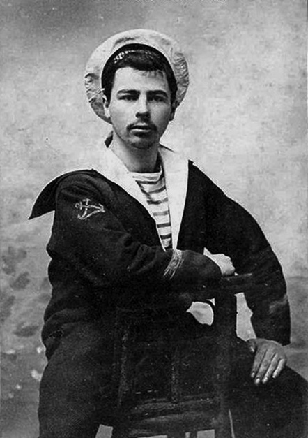 A French sailor in uniform, circa 1910. The marinière, a long-sleeved knit undershirt with blue and white horizontal stripes, became part of the French Naval uniform in 1858. (Author unknown. Source: Wikimedia Commons.)