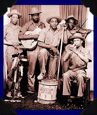 The Memphis Jug Band, an early blues group, whose lyrical content and rhythmic singing predated rapping. Memphis jugband.jpg