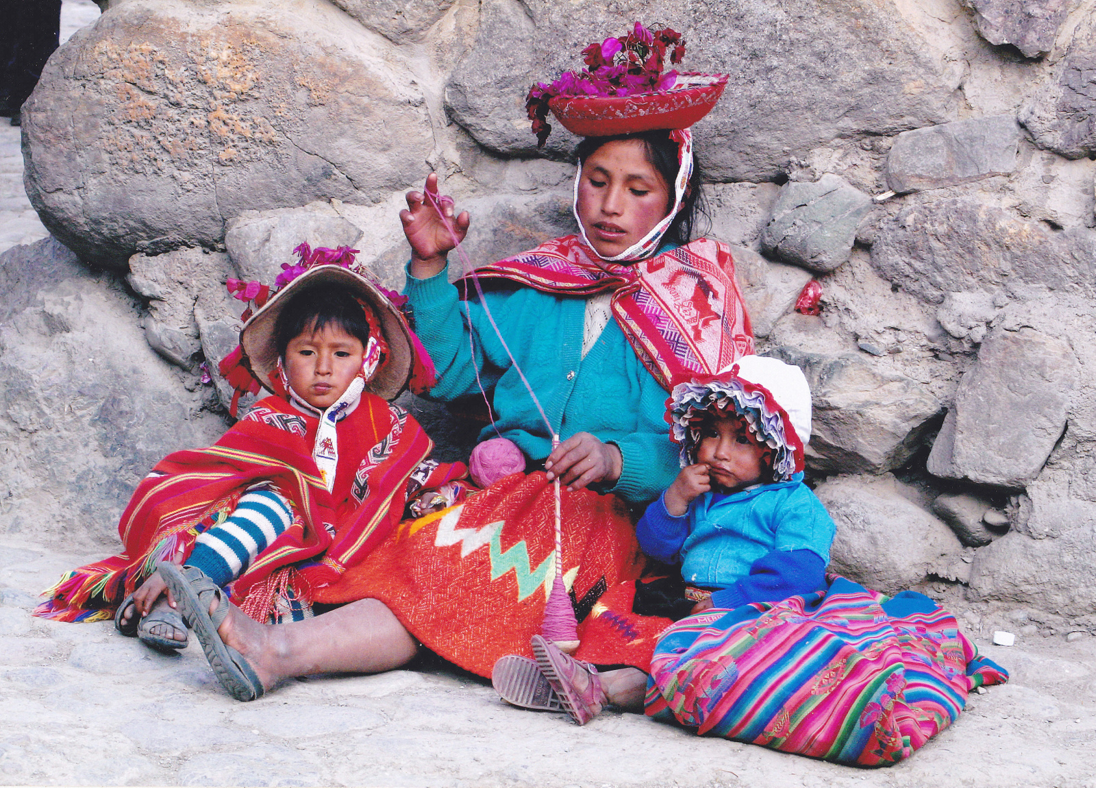 Description quechua woman spinning and her children peru