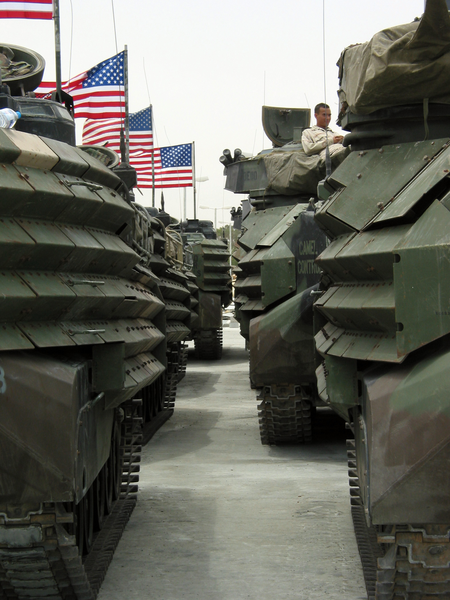 Us Navy N K A Lone Marine Sits Amongst A Sea Of Flags And Amphibious Assault Vehicles Aav At Camp Patriot Kuwait