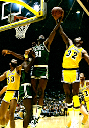 1e5ed7a322e Johnson (right) battles Boston s Cedric Maxwell in 1985 NBA Finals