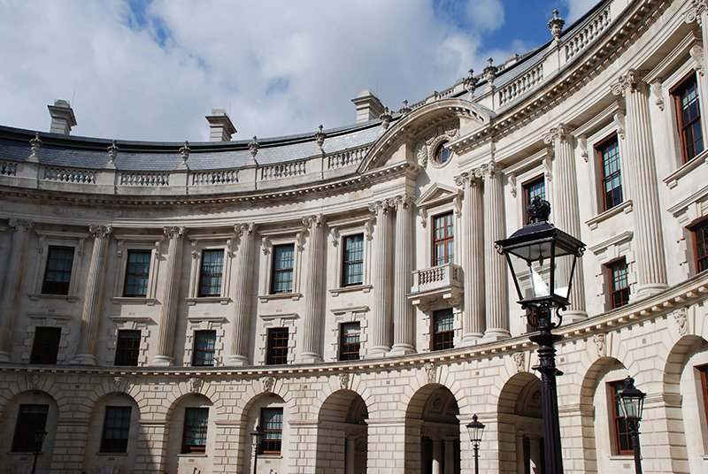Photo showing the inner courtyard and facade of the HM Treasury building.