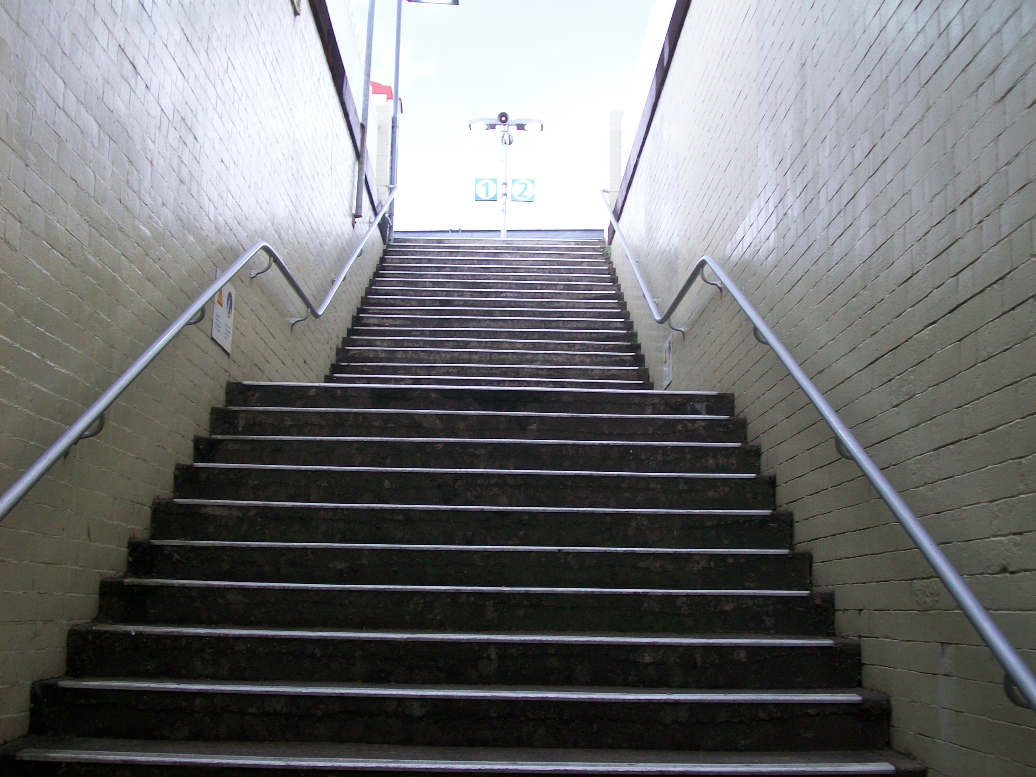 [Image: Macdonaldtown_Railway_Station_stairs_to_platform.jpg]
