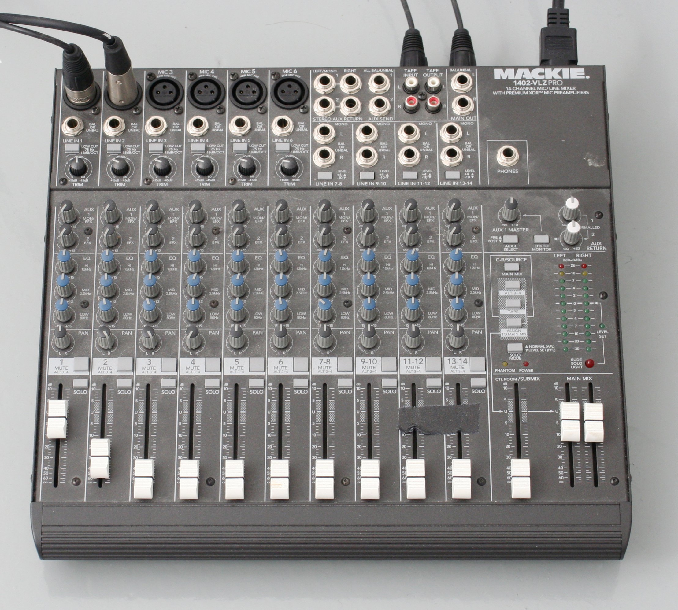An Mackie 1402 with 12 sliders, two XLR jacks plugged in and two out, no USB