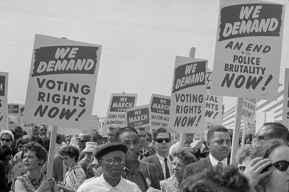 Marchers with signs at the March on Washington, 1963.jpg
