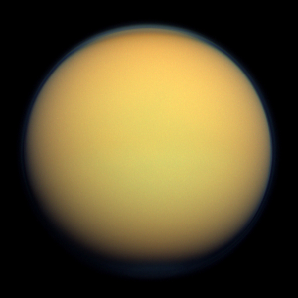 Titan's atmosphere makes Saturn's largest moon look like a fuzzy orange ball in this natural color view from the Cassini spacecraft. Source: Wikipedia