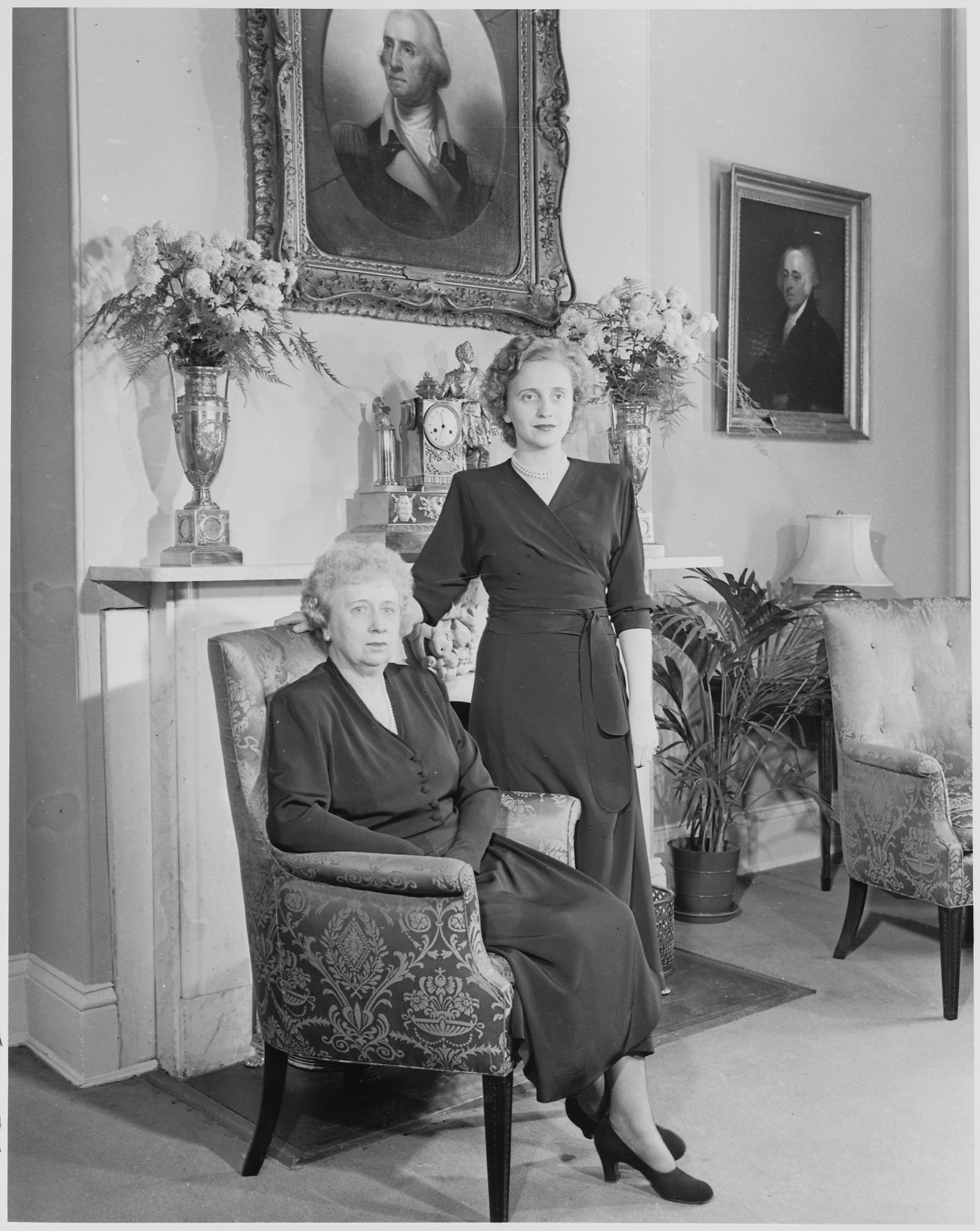 File First Lady Bess Truman poses with her daughter Margaret in front of the fireplace at
