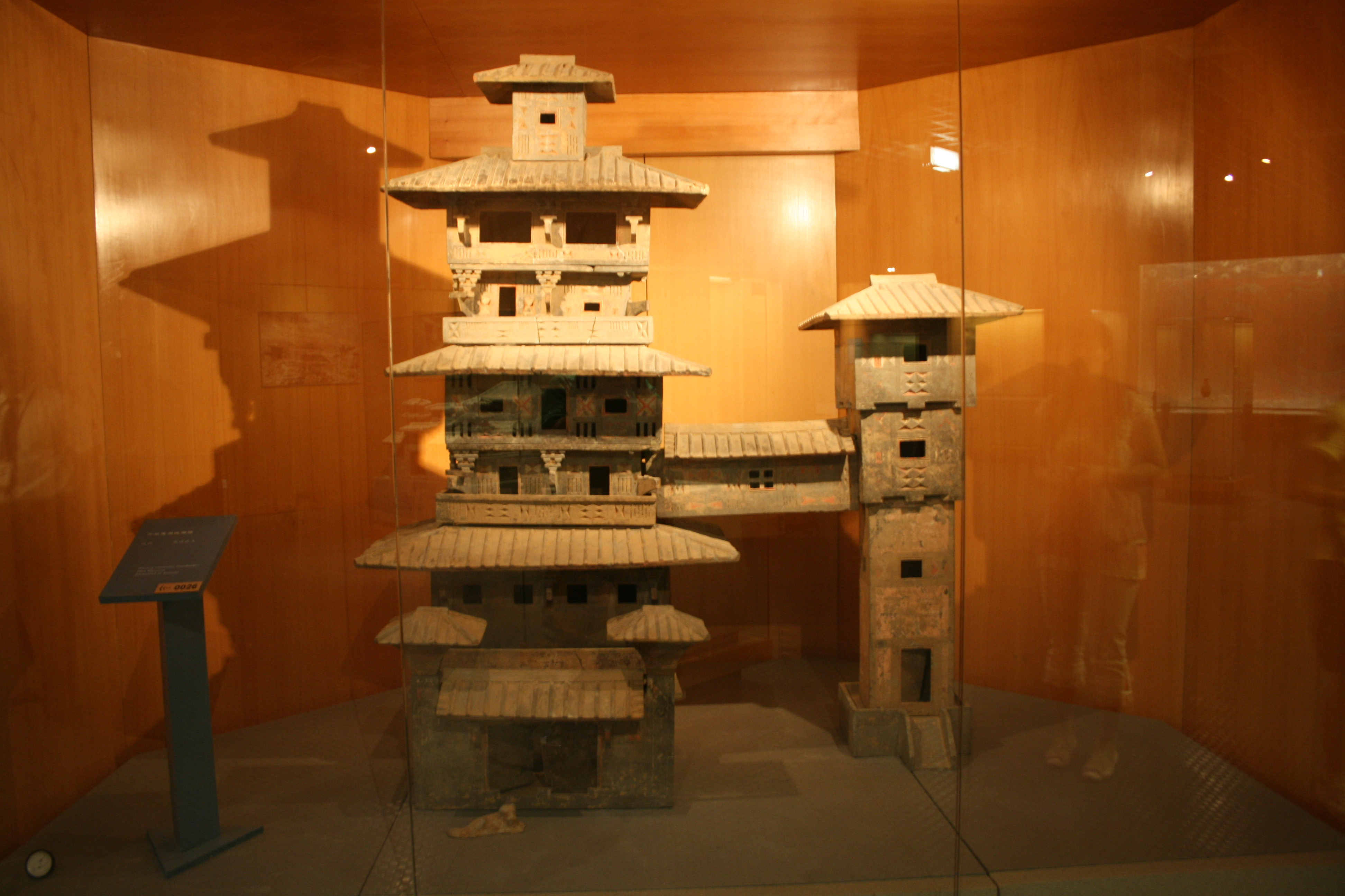 A Han Dynasty (202 BC 220 AD) Chinese miniature model of two residential towers joined by a bridge