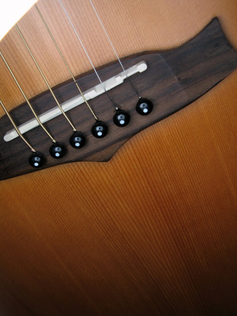 how to change a bridge on an acoustic guitar