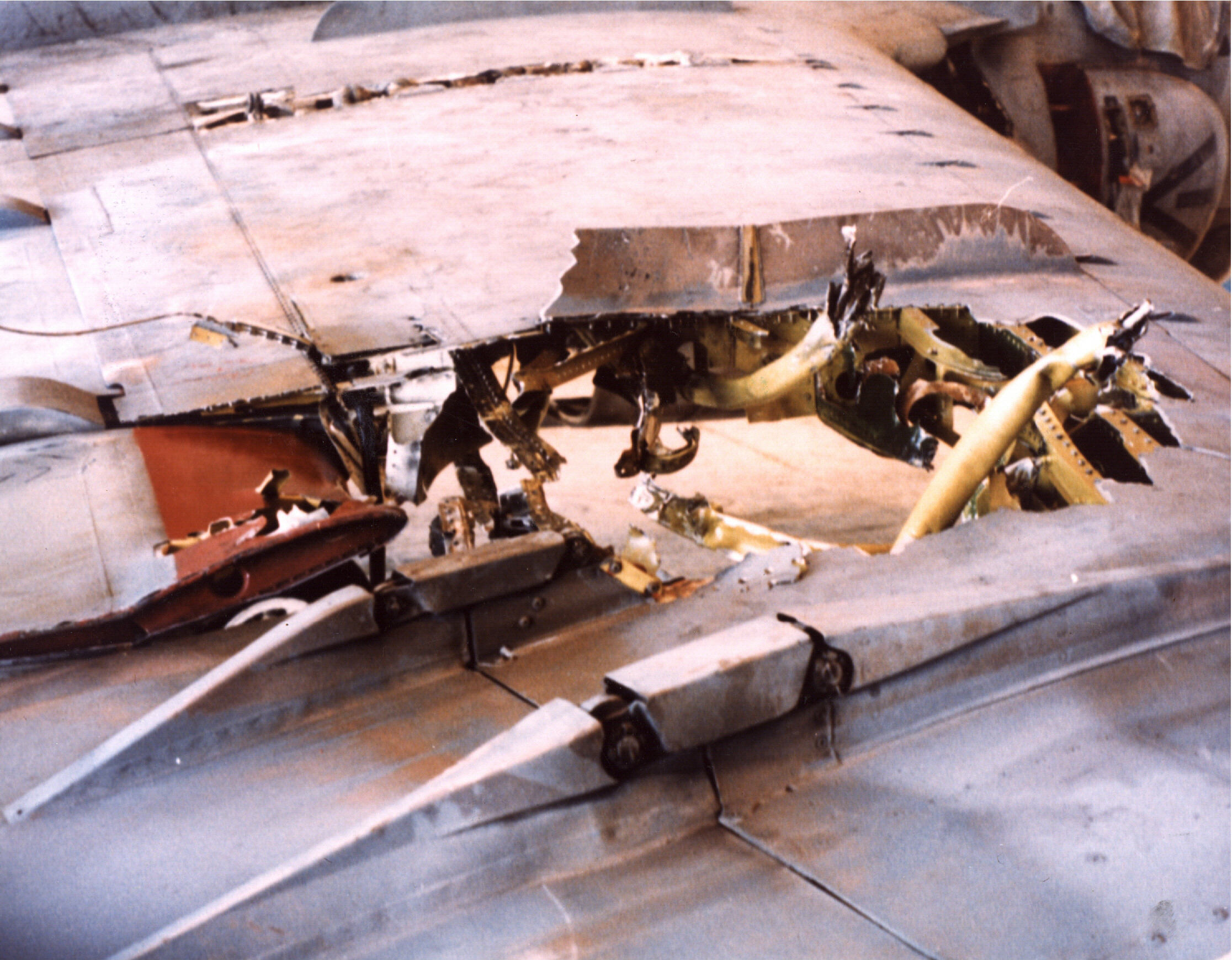 http://upload.wikimedia.org/wikipedia/commons/4/47/A-6E_flak_damage_to_wing_dring_1991_Gulf_War.jpeg