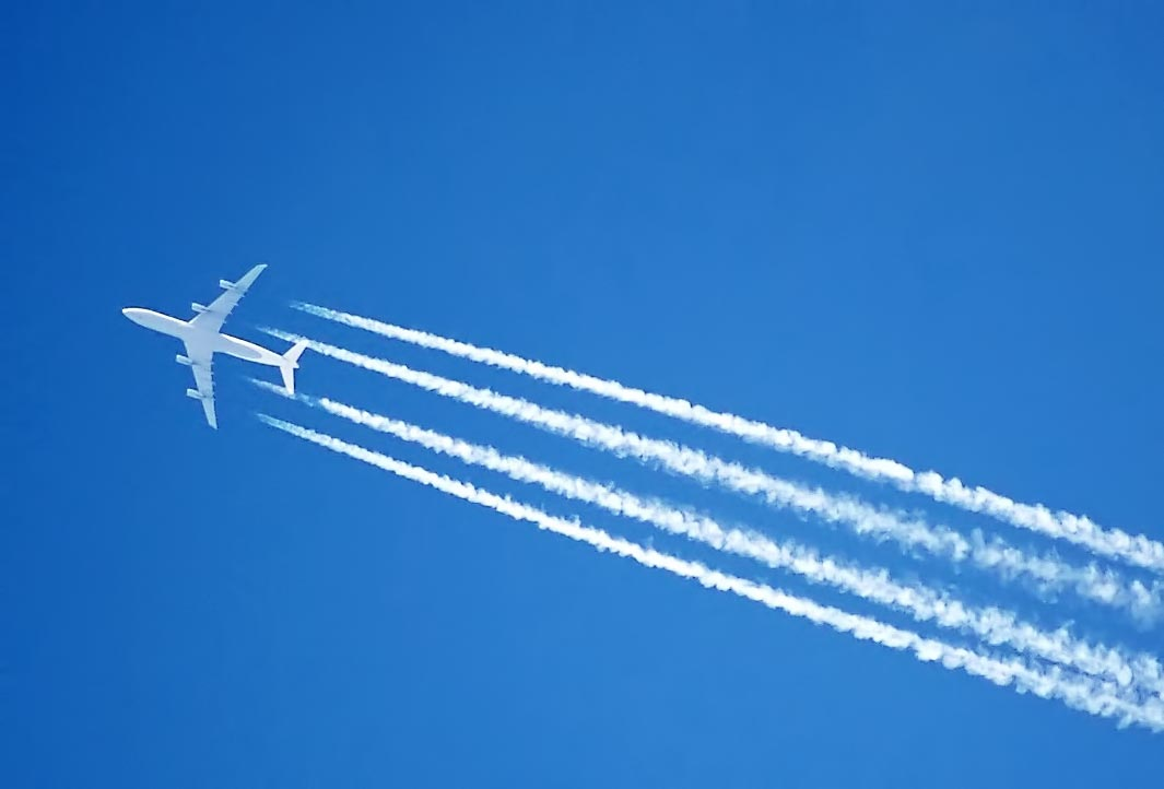 Contrails behind a plane in the chemtrails article on wikipedia