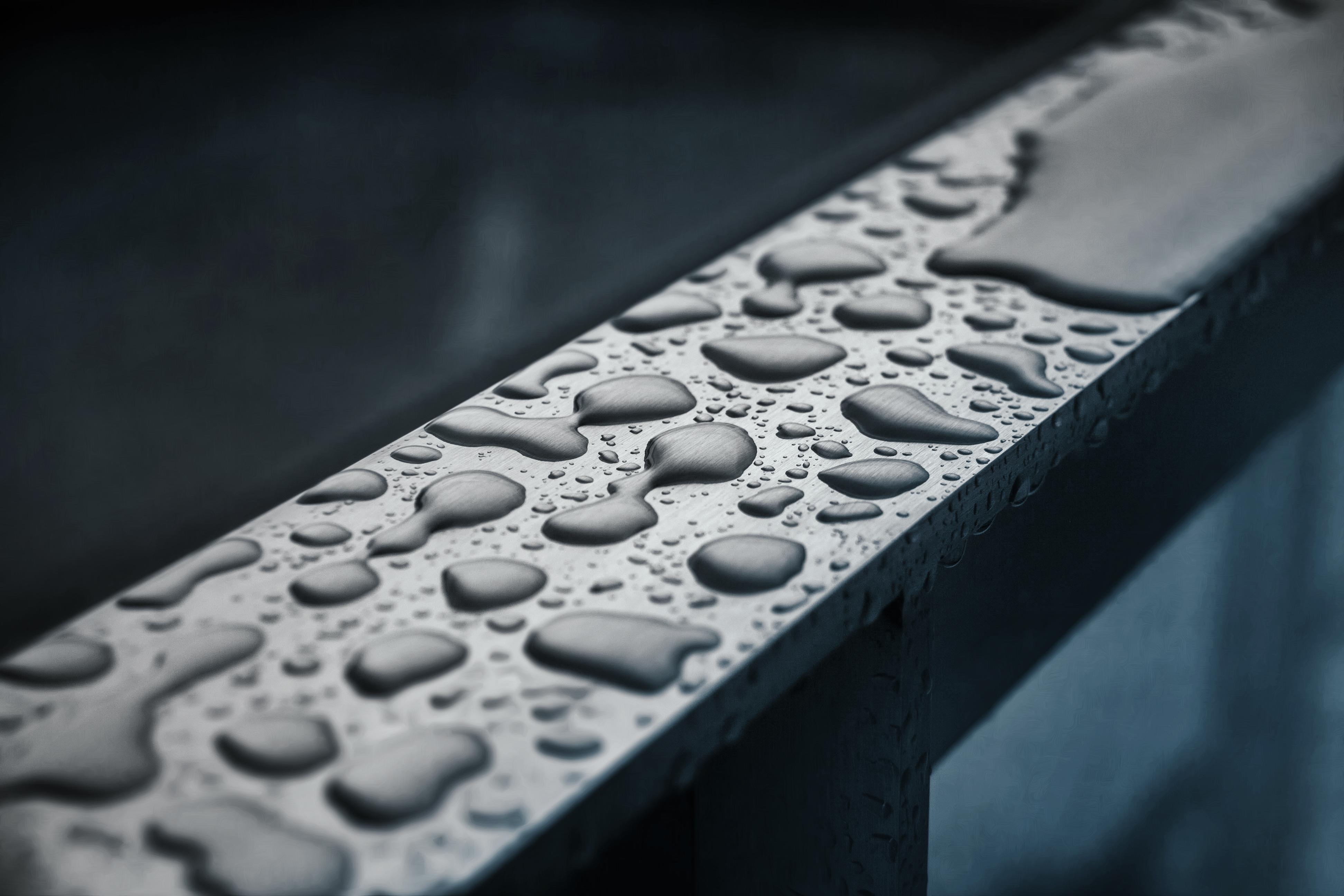 Raindrops on a railing. WikiCommons Juanedc