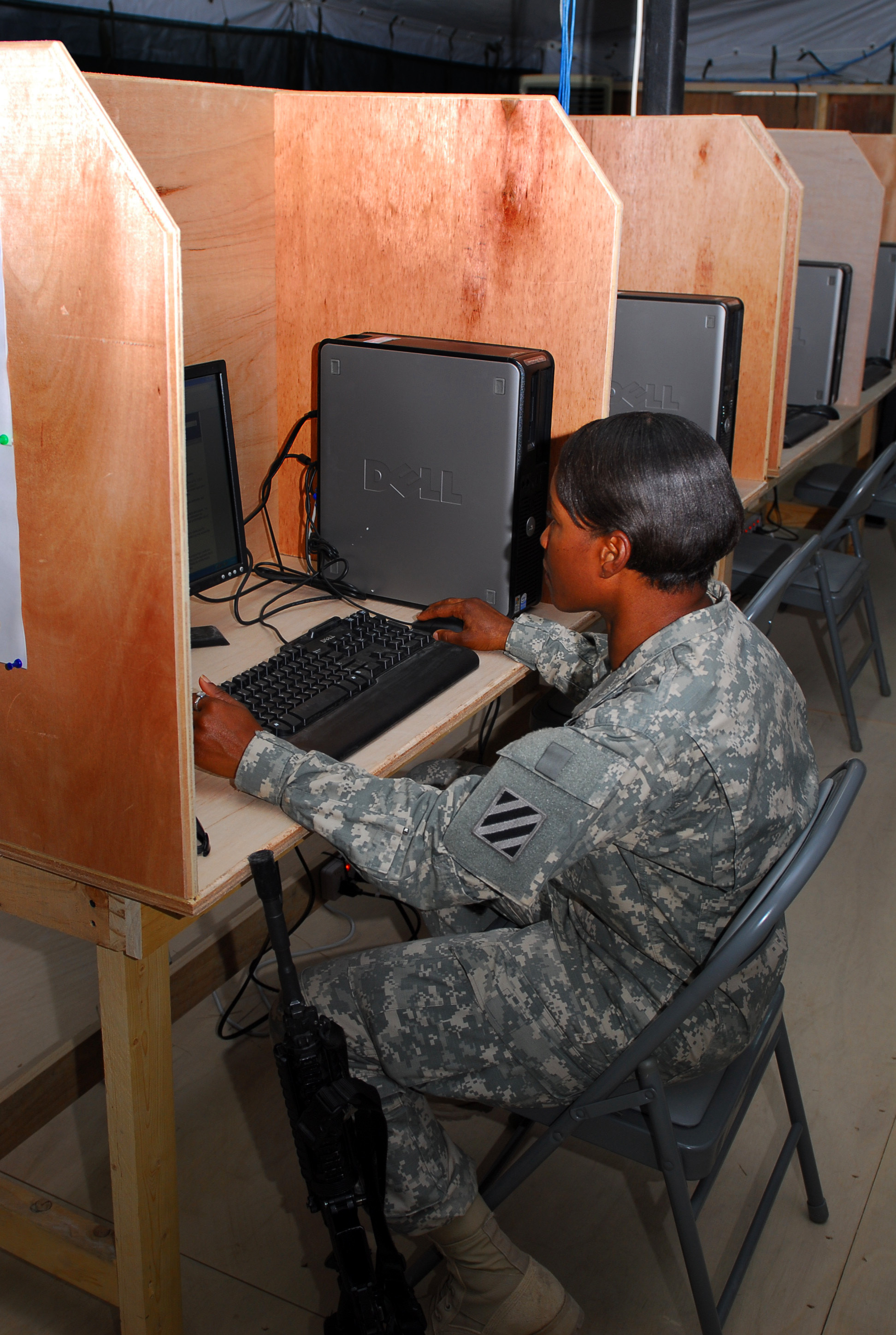 Soldier using a computer at a distance learning center