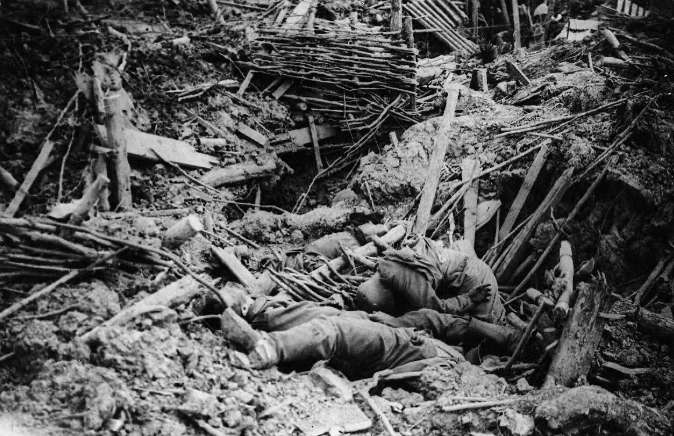 Smashed up trench on Messines ridge with German casualties