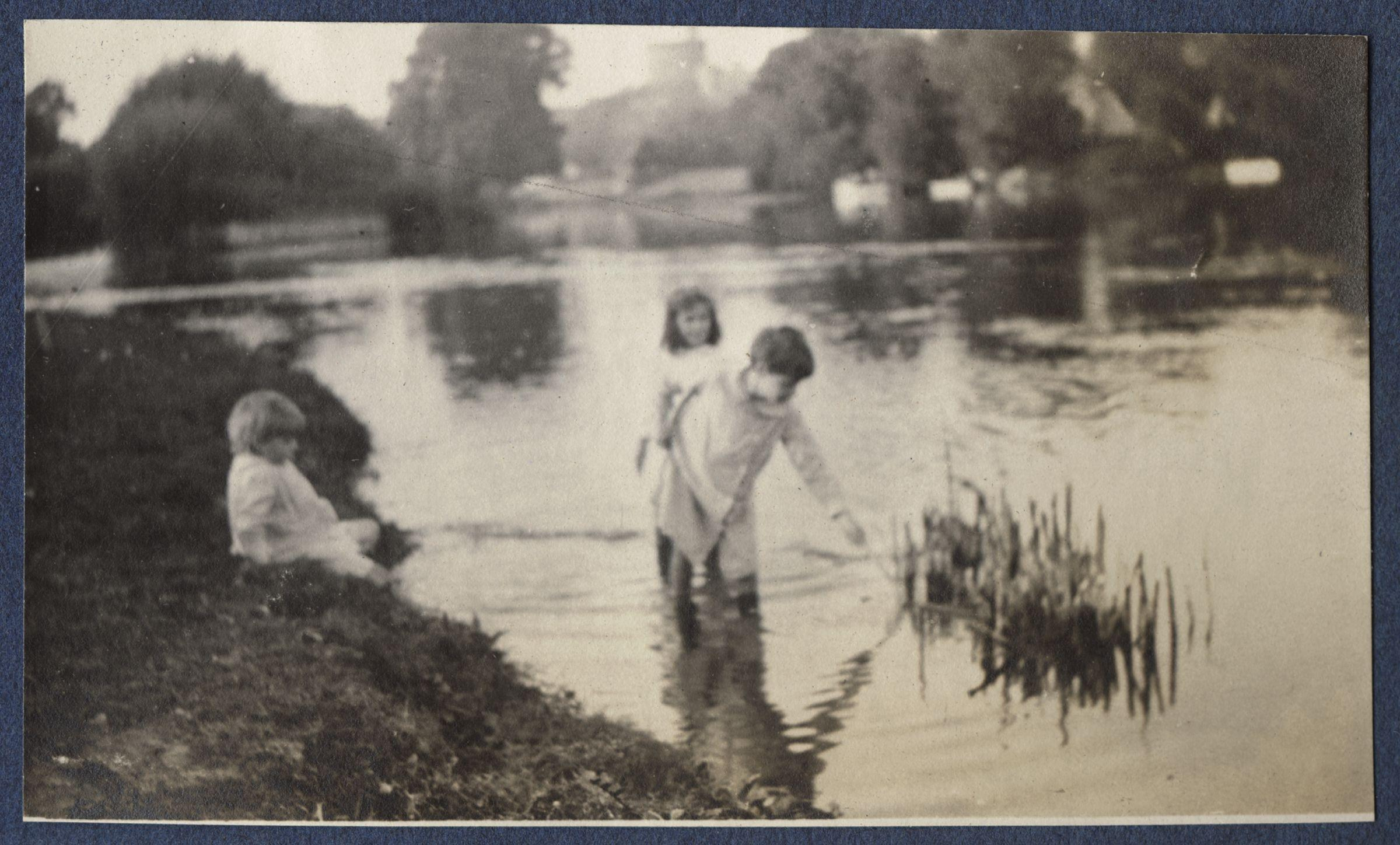 Description three unknown children playing in the river thames by lady