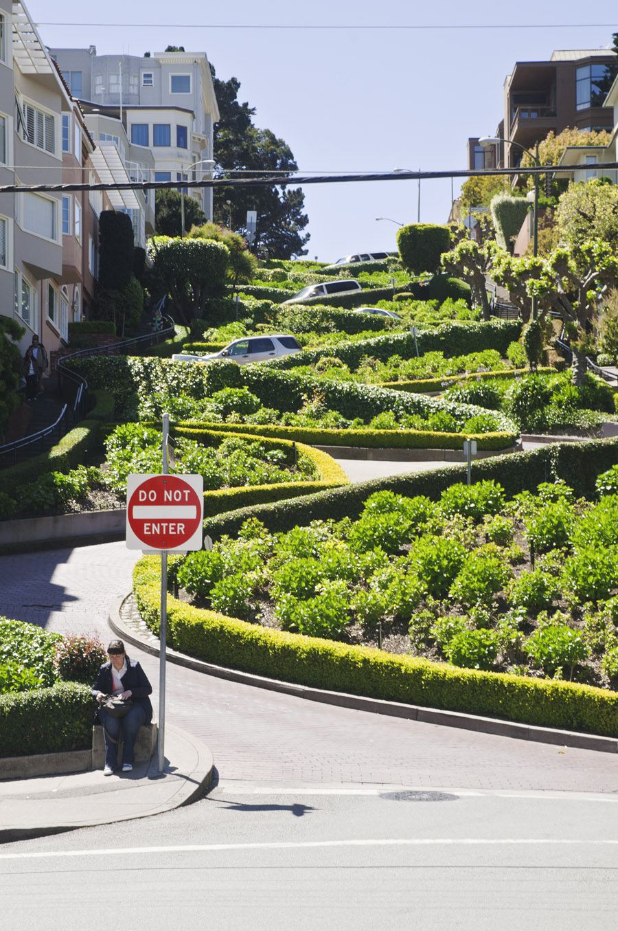 Cars driving down the seven bends of Russian Hill's Lombard Street tests your nerve