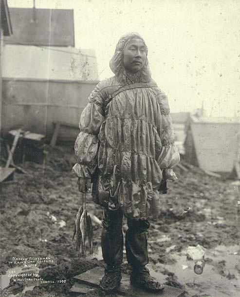 file eskimo man wearing gut parka and holding fish  nome