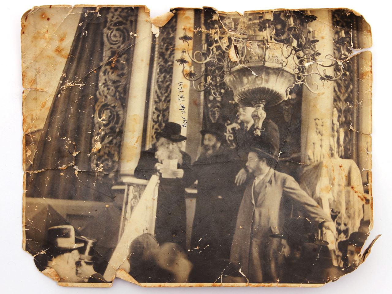 sepia photograph shows a rabbi standing on the synagogue podium ...