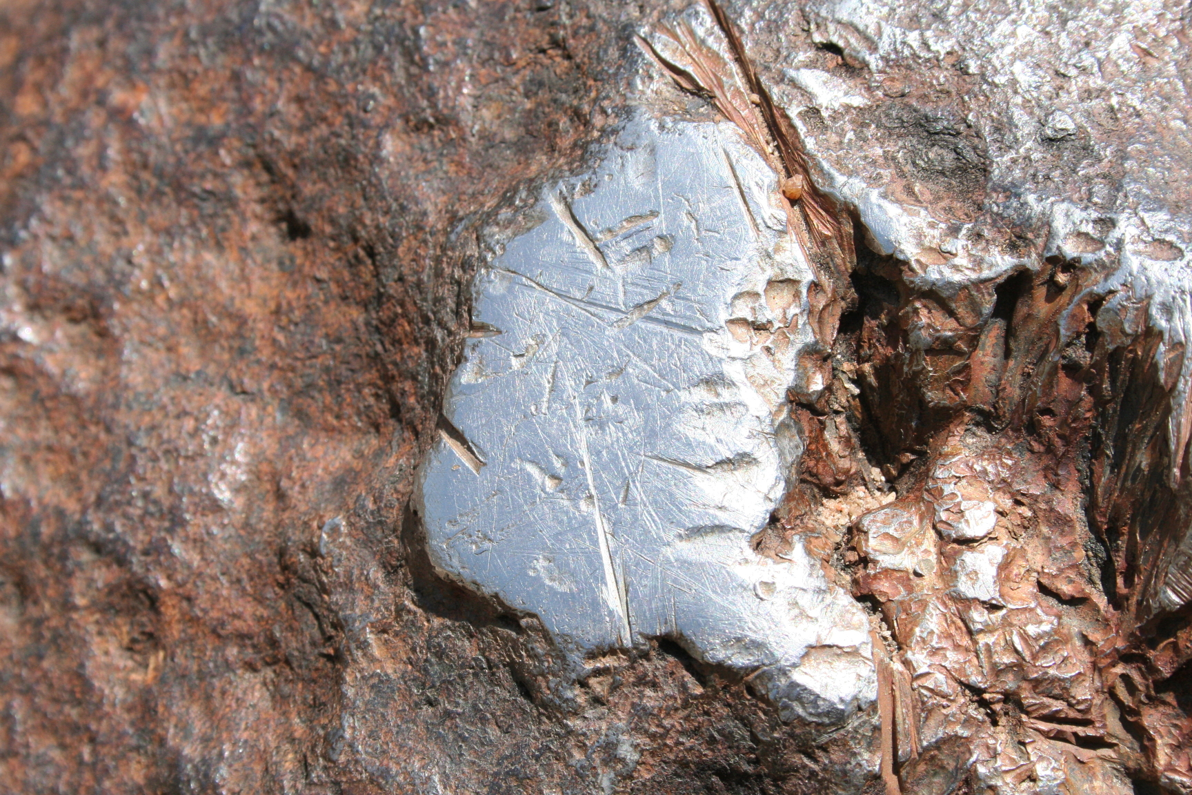 Ultra-close-up of Hoba Meteorite, showing vandalism of the surface before it was declared protected by Namibian Government