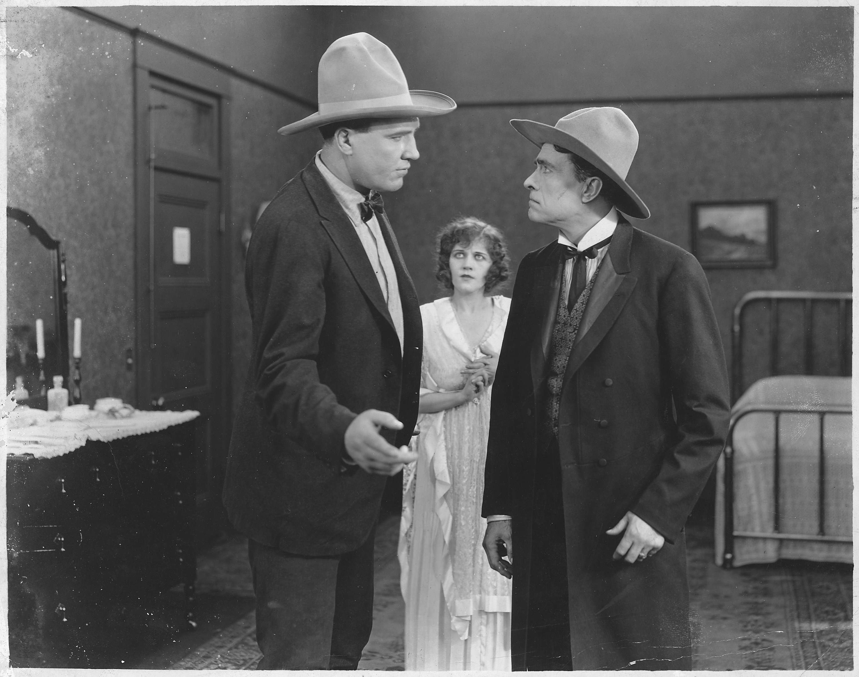 old movie still, two men in cowboy hats
