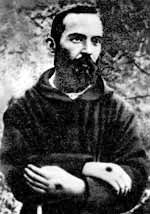 A young Padre Pio showing the stigmata
