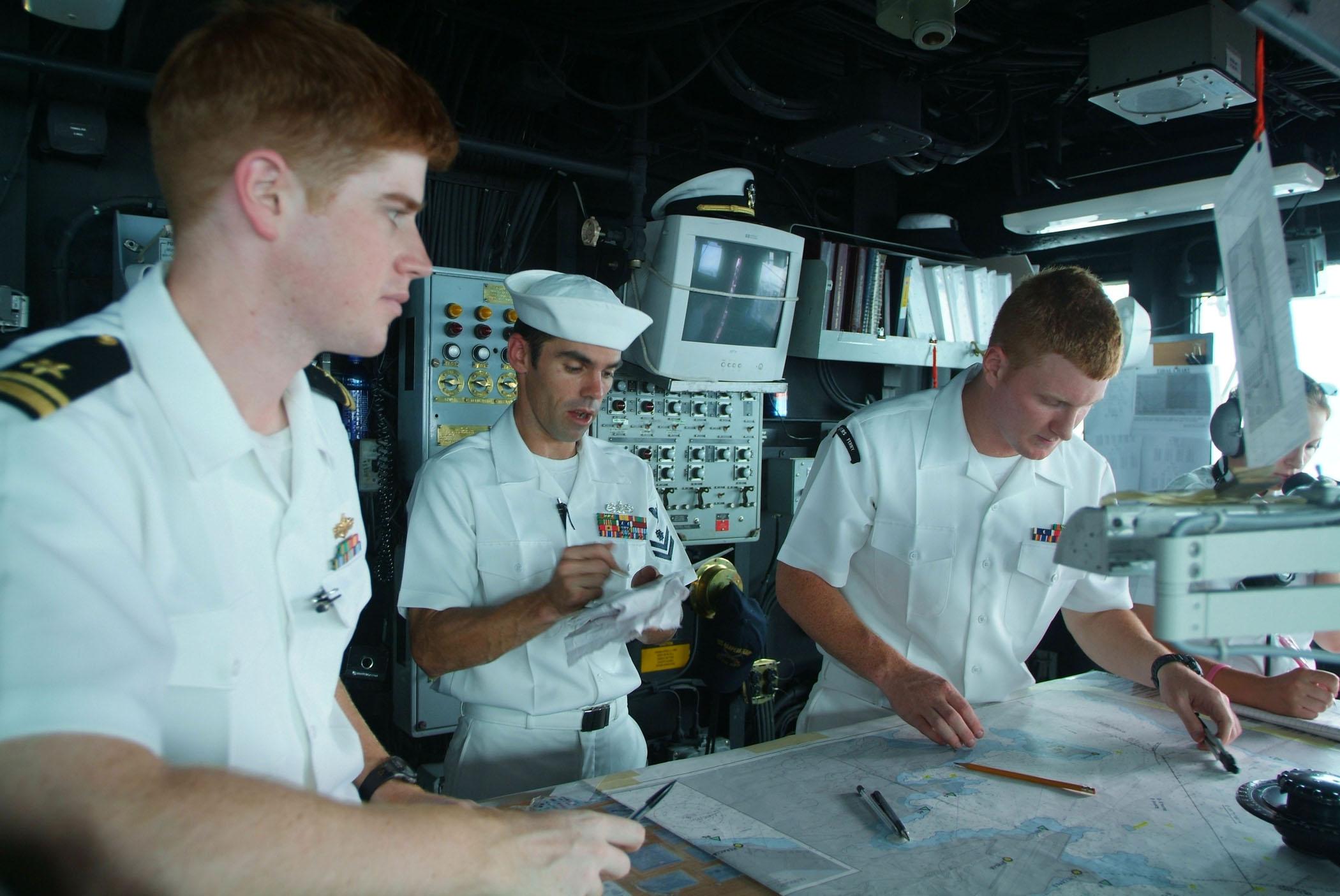 File:US Navy 050815-N-4772B-044 From left, Navigator Lt.j.g. ...