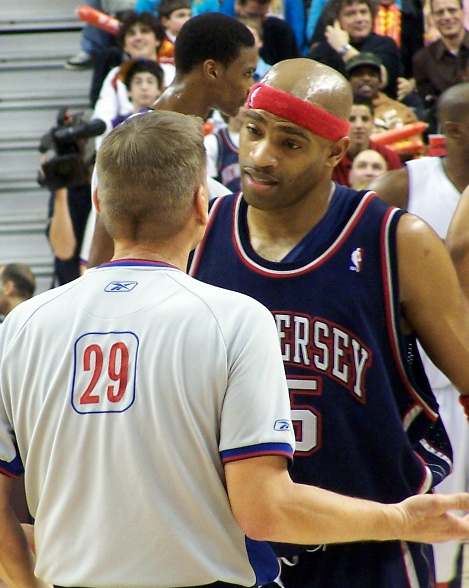 Vince Carter talks with a referee.