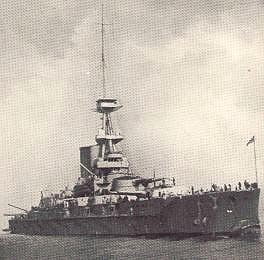 A black and white picture of a ship 45 degrees to the right, with a gun turret visible