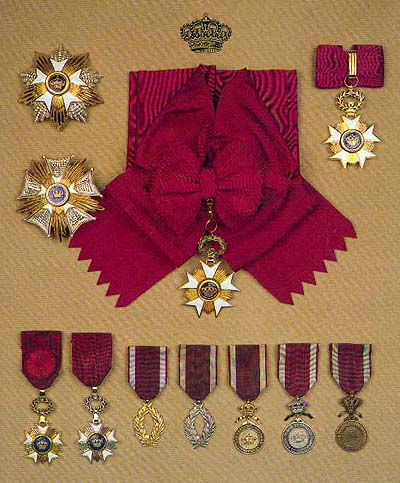 Top left: Grand Cross' star, middle left: Grand Officer plaque, top center: Grand Cross' sash, top right: Commander's cross, bottom, from left to right: Officer's cross, Knight's cross, Gold Palms, Silver Palms, Gold Medal, Silver Medal, Bronze Medal (courtesy Société de l'Ordre de Léopold)
