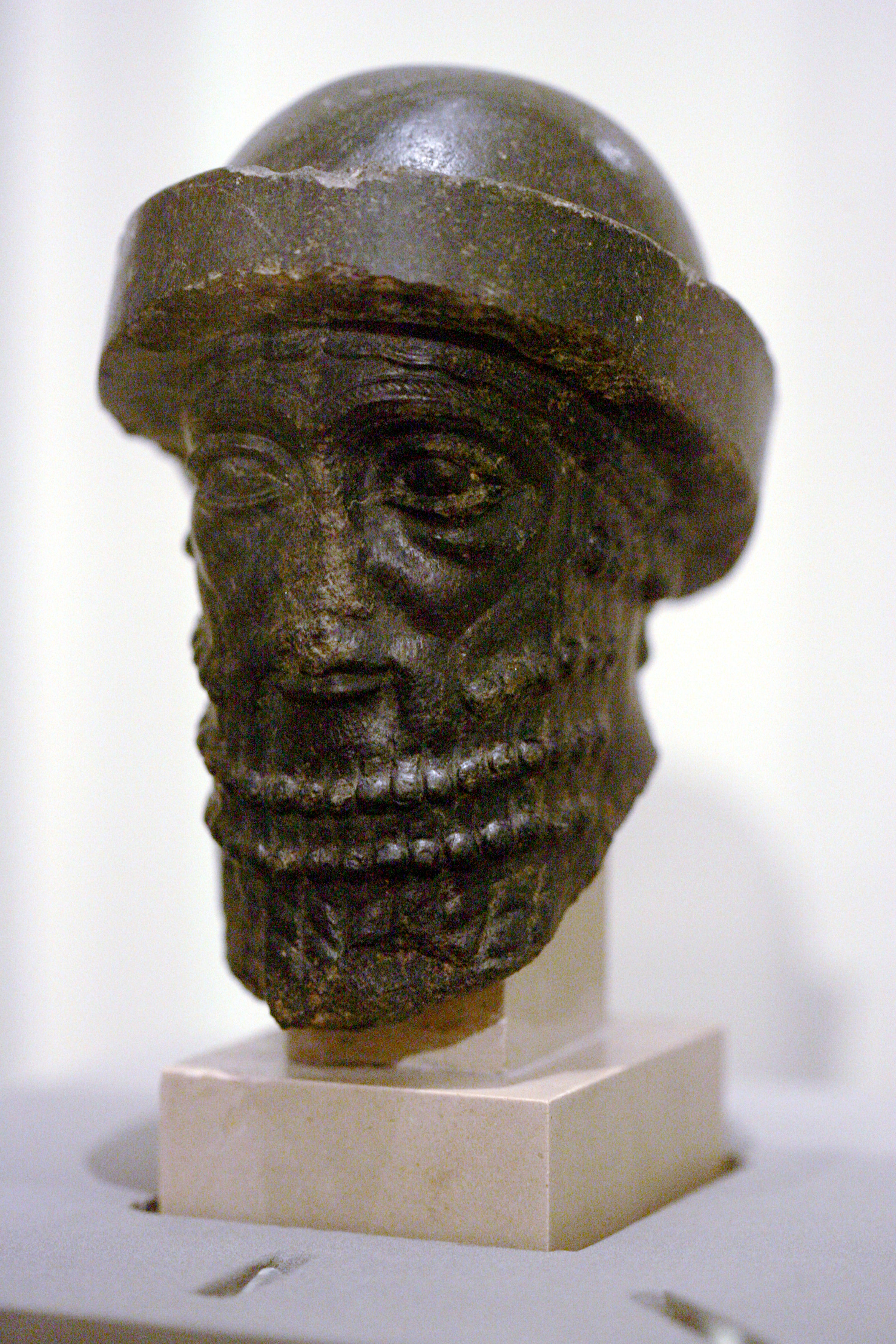 A stone statue depiction of King Hammurabi.