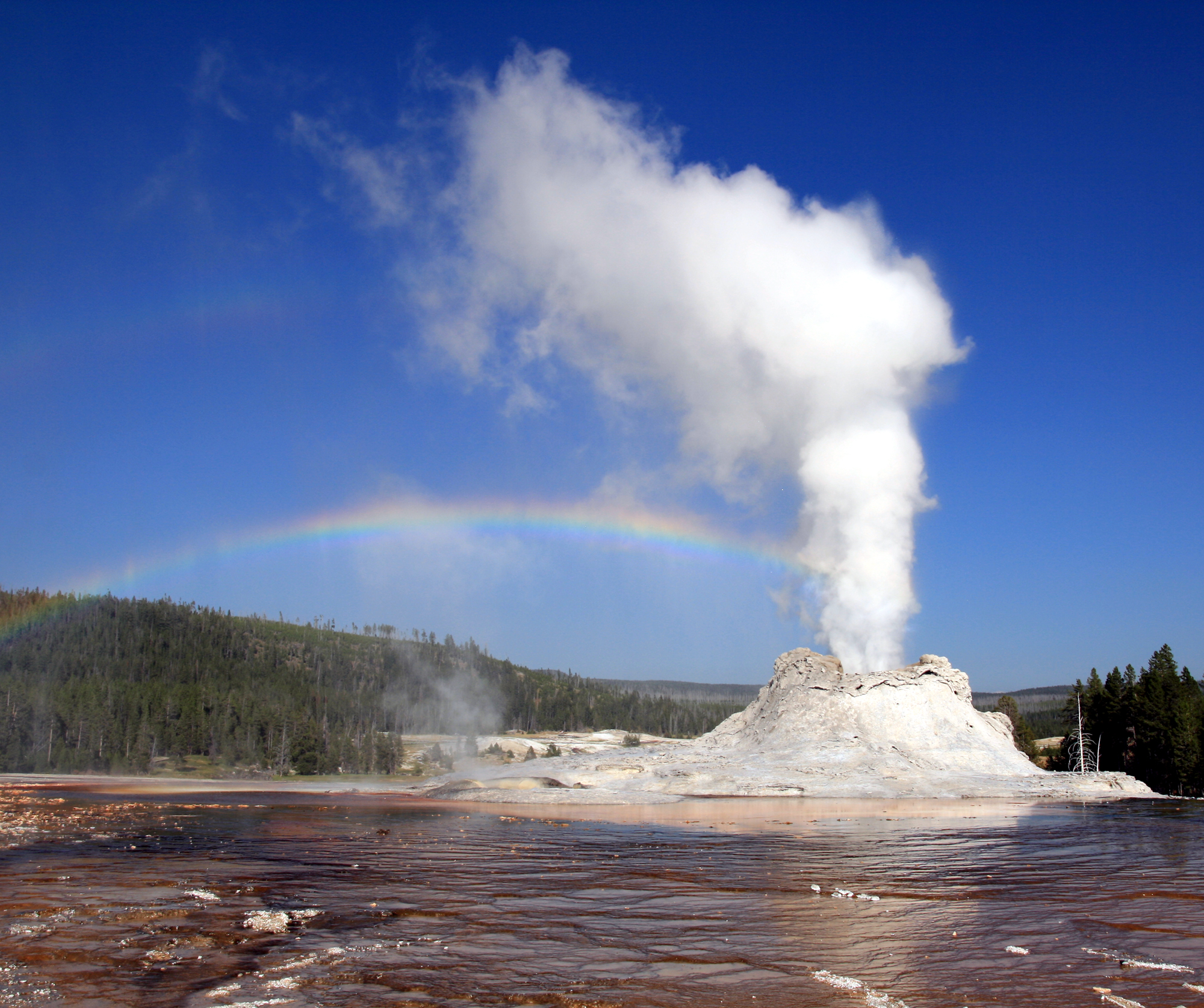 Description Steam Phase eruption of Castle geyser with double rainbow